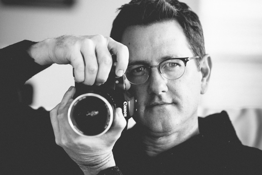 Photographer Robin Rowell shown with a Zeiss Distagon 35mm 1.4 prime lens