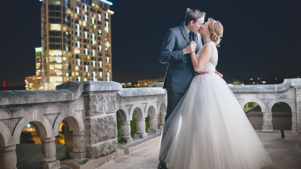 A romantic wedding kiss on the top floor of the Chateau Bellevue in Austin, Texas